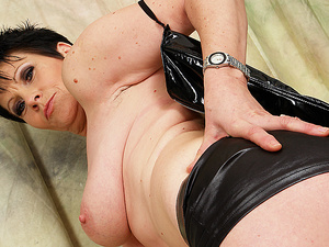 Hot mature mama playing with a dildo
