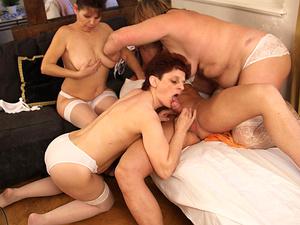 Three mature sluts share one hard cock
