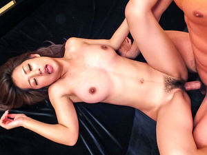 Satomi Suzuki sucks one cock and another is inside her