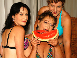 Three old and young lesbians getting wet