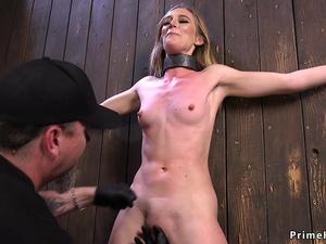 Skinny blonde tormented in device bondage