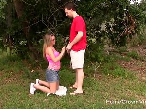 Big tit blonde amateur jerks off a cock outdoors