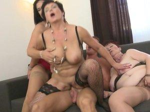 Three naughty mature ladies sharing one hard cock