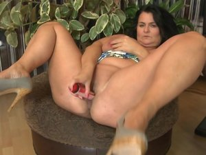 Huge breasted mature lady playing with her wet pussy