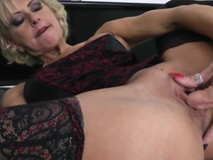 Pierced blonde MILF playing with a huge dildo