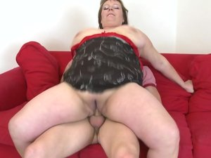 Big breasted mature slut having sex with her toy boy