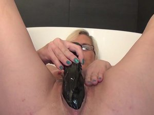 Mature slut masturbating and pissing over herself