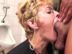 Horny blonde mature slut sucking cock on the toilet