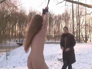 Sever dominator torments his slave outside in winter