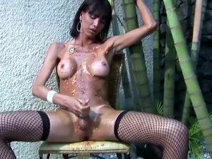 Tgirl fucks her ass with papaya and jerks off her big cock