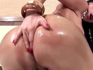 Bigtitted shemale oiled up and ready to stroke her big cock